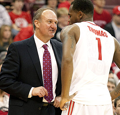 Three-hundred-game winner Thad Matta gives kudos to Buckeyes F Deshaun Thomas, who finishes with 11 points. (US Presswire)