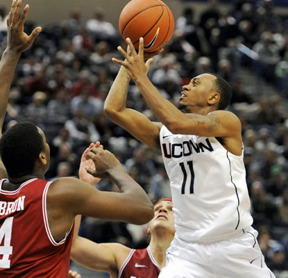 Ryan Boatright dominates in his home debut for UConn, scoring 23 points while hitting 8 of 12 shots.  (AP)