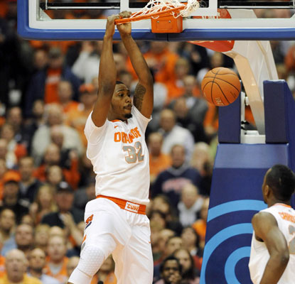 Kris Joseph does his work inside with 11 points and eight rebounds, and the Orange improve to 9-0.  (US Presswire)