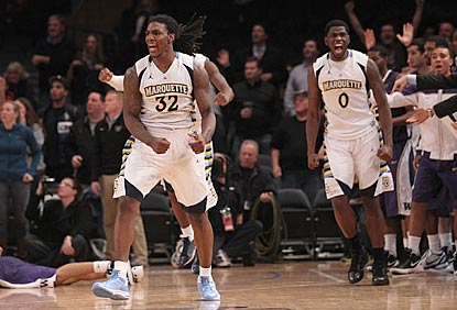 Jae Crowder (32) and Jamil Wilson react -- as do their opponents -- as time runs out moments after Crowder's go-ahead trey.  (US Presswire)