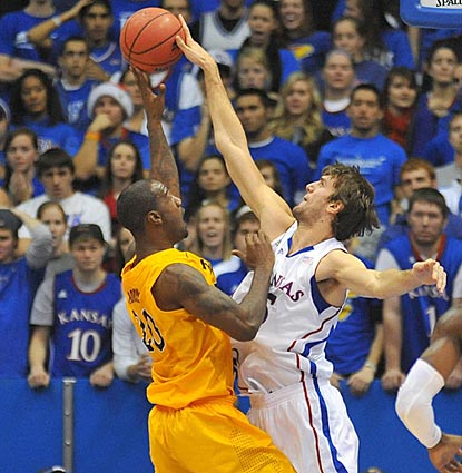 Kansas center Jeff Withey (right) rejects Long Beach State forward T.J. Robinson in the first half.  (US Presswire)