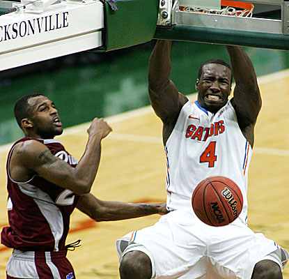 Gators' center Patric Young slams home two of his 12 points as Florida cruises by Rider.  (US Presswire)