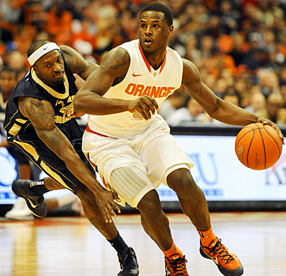 Syracuse's Dion Waiters drives past the Colonials for a career-high 19 points and six steals. (US Presswire)