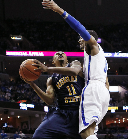 Donte Poole drives here but does most of his damage from downtown, connecting on six treys. (AP)