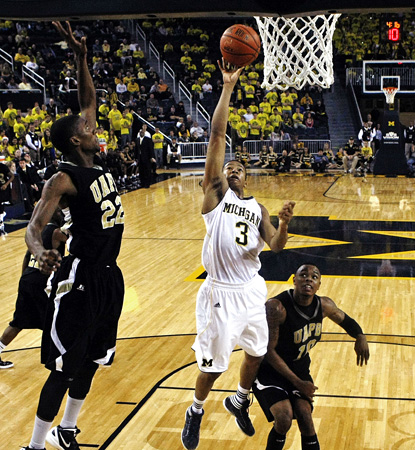 Trey Burke scores two of his 15 total points for the game.  Thirteen of his total come in the first half. (AP)