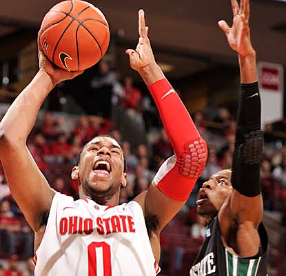 Player of the Year candidate Jared Sullinger posts 12 points and 10 rebounds in his return for the Buckeyes.  (Getty Images)