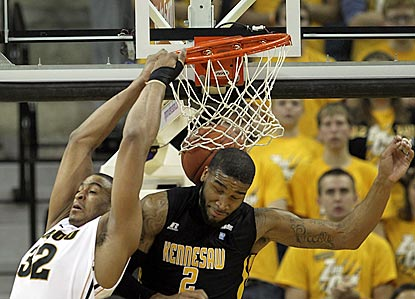 Missouri forward Steve Moore (left) posterizes Kennesaw State's Markieth Cummings with a backward dunk.  (Getty Images)