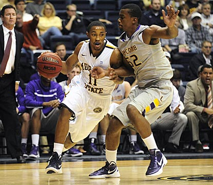 Murray State's Donte Poole (11) drives by Lipscomb's Malcolm Smith in the first half.  (AP)