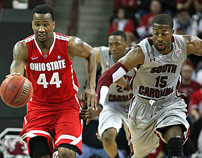 Ohio State's William Buford, who scores 17 points, leads a fast break while being pursued by South Carolina's Malik Cooke. (US Presswire)