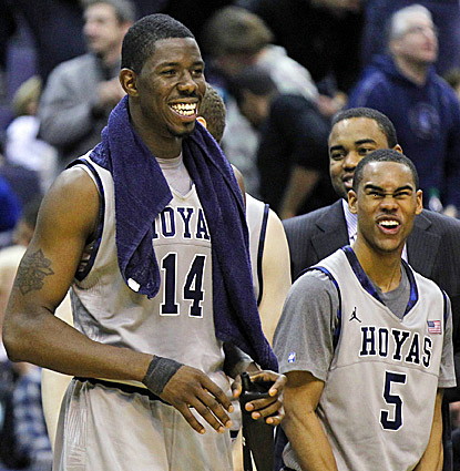 Henry Sims (left) and Markel Starks, who combine to score 35 points, enjoy Georgetown's win over American. (AP)