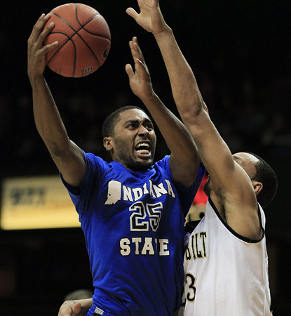 Steve McWhorter drives here for Indiana State, but his key contribution comes on defense against Vandy's John Jenkins. (AP)