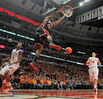 Mike Moser helps UNLV pull off the upset in Chicago with 17 points and 11 rebounds.   (Getty Images)