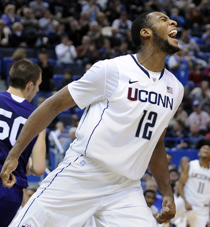 The Huskies are led by freshman Andre Drummond, who scores 24 points and grabs eight boards. (AP)