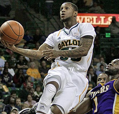 Baylor's Pierre Jackson scores seven points and adds four assists in a win over Paul Quinn. (AP)