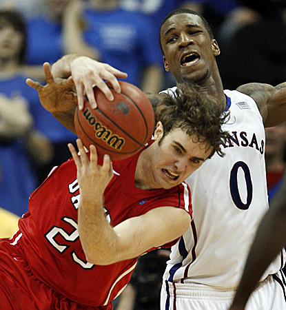 Davidson's Tom Droney (left) is fouled by Kansas forward Thomas Robinson. Droney grabs a team-best six rebounds in the win. (AP)