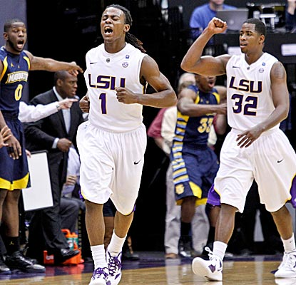 LSU guards Anthony Hickey and John Isaac celebrate the Tigers' win over No. 10 Marquette. (US Presswire)