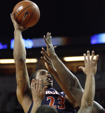 Mike Scott scores a career-high 33 points to help Virginia avoid an upset against Seattle. (Getty Images)