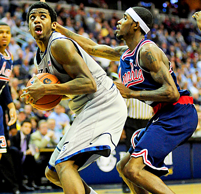 Georgetown's Hollis Thompson pushes against Memphis for 17 points and nine rebounds. (US Presswire)