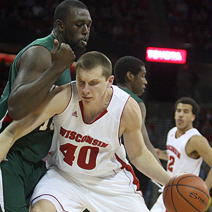 Wisconsin's Jared Berggren (right) drives to the hoop against MVSU's Amos Studivant in the Badgers' blow-out win. (US Presswire)