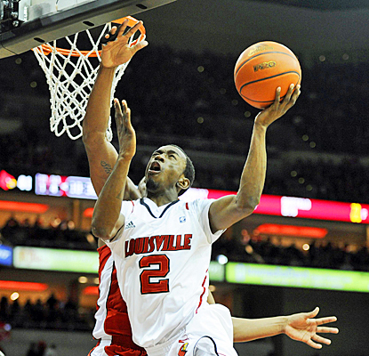 Louisville gets a lift from the bench as Russ Smith guides the Cardinals with a game-high 23 points. (US Presswire)