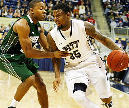 Josh Thompson helps Wagner hold Nasir Robinson and No. 15 Pitt to 39 percent shooting. (US Presswire)