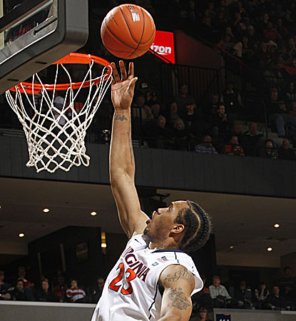 After spending most of the first half on the bench, Virginia's Mike Scott erupts for a game-high 17 points. (AP)