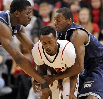 Georgetown ties up Louisville's Russ Smith while ending the Cardinals' 20-game home winning streak.  (AP)