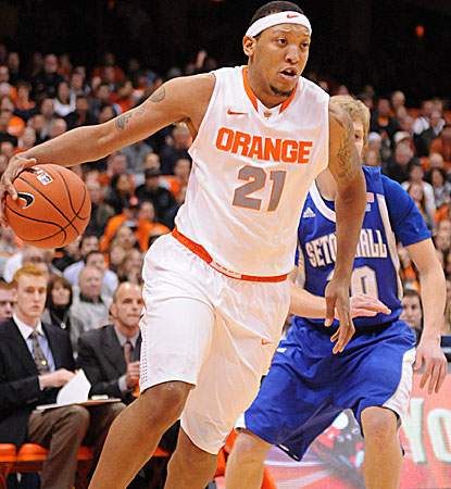 Mookie Jones takes it to the hoop as Syracuse wins in its Big East opener to remain undefeated. (US Presswire)