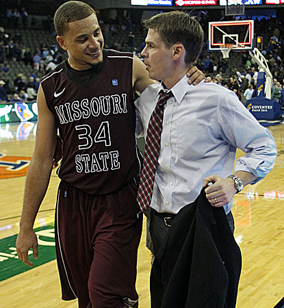 The Bears' Kyle Weems (with head coach Paul Lusk) is all smiles after a career-high 31 point performance. (US Presswire)