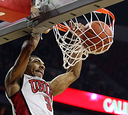 Anthony Marshall dunks home two of UNLV's 124 points -- the program's highest total since the 1990-91 season. (AP)