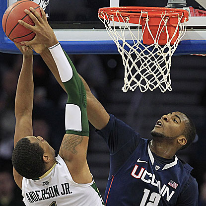 UConn's Andre Drummond denies South Florida's Ron Anderson Jr. as the Huskies win their Big East opener. (AP)
