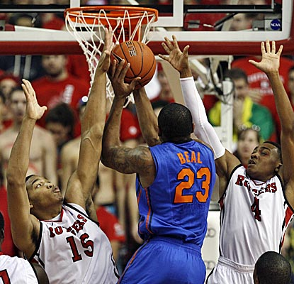 Derrick Randall, left, grabs eight rebounds in Rutgers' upset of No. 10 Florida.  (AP)