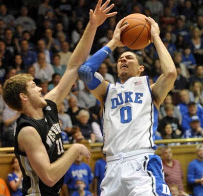 Freshman Austin Rivers scores 20 points as Duke stretches its home winning streak to 42. (AP)