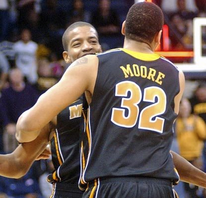 Missouri's Kim English (16 points) celebrates a hard-fought victory with Steve Moore.  (AP)
