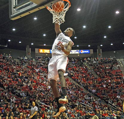 Aztec guard Jamaal Franklin soars for a dunk and finishes the night with 26 points, six steals and 10 rebounds.   (AP)