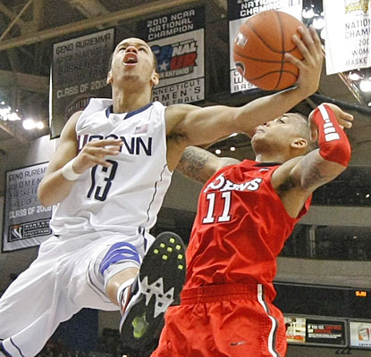 Shabazz Napier scores 17 points while reminding his fellow Huskies to keep playing even with a big lead.  (US Presswire)