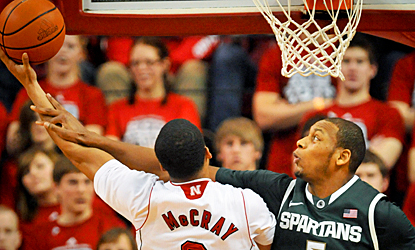 Adreian Payne and the Spartans' defense holds Nebraska to just 36 percent shooting. (AP)