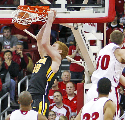 Aaron White scores 18 points in just 20 minutes off the bench as Iowa earns a huge road victory.  (AP)