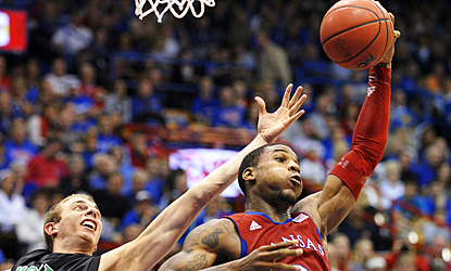 Thomas Robinson pulls down one of his career-high 21 rebounds to help Kansas crush North Dakota. (AP)