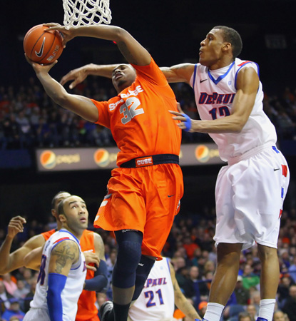 Kris Joseph scores two of his 22 to help secure the Orange's 15th consecutive victory. (US Presswire)