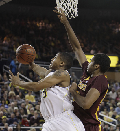 The Wolverines need every one of Trey Burke's season-high 27 points in a close one against Minnesota. (AP)