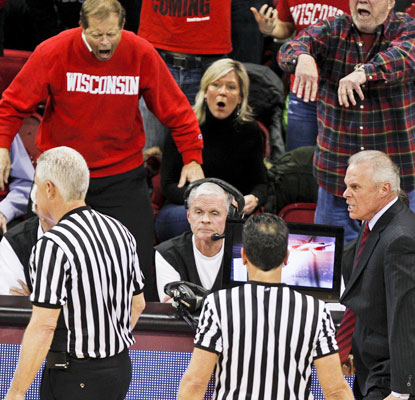 Wisconsin coach Bo Ryan and Badgers fans show their displeasure with the officials' decision to negate a late 3-pointer.  (AP)