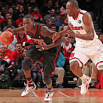 Gorgui Dieng (left) breaks the Red Storm's  press in the Cardinals' return to the win column. (US Presswire)