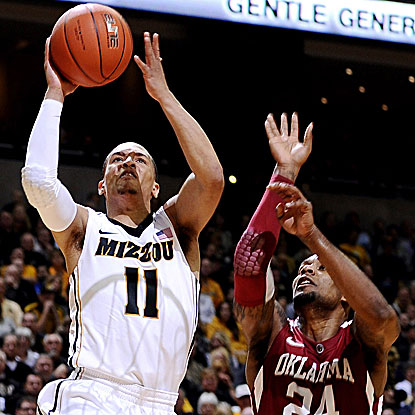 The Tigers' Michael Dixon (11) comes off the bench to contribute 13 points and four assists.  (US Presswire)