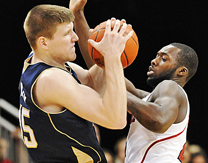 Notre Dame's Jack Cooley, who leads the Irish with 18 points and 10 rebounds, battles with Rakeem Buckles for the ball. (AP)