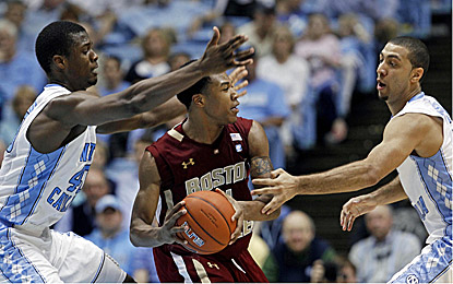 North Carolina's Harrison Barnes (left) scores 25 points to help UNC shut down Boston College in an ACC showdown. (AP)