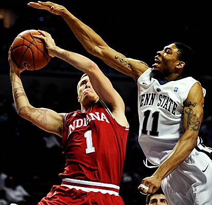 Indiana's Jordan Hulls drives on Penn State defenders, finishing with 28 points in the Hoosiers' road win. (Getty Images)