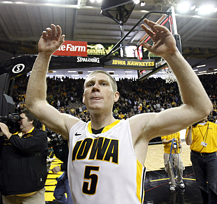 Senior guard Matt Gatens celebrates Iowa's upset win over No. 13 Michigan after leading the Hawkeyes with 19 points. (AP)