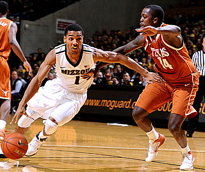 Phil Pressey (left) scores seven consecutive points during the second half to help Missouri hold off Texas. (US Presswire)