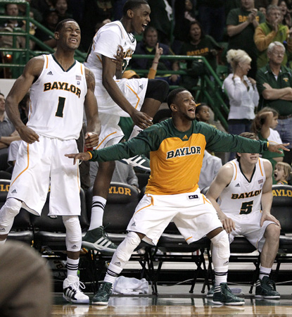 Perry Jones III (1) celebrates with teammates after his double-double helps Baylor blow OK State out of the building. (AP)